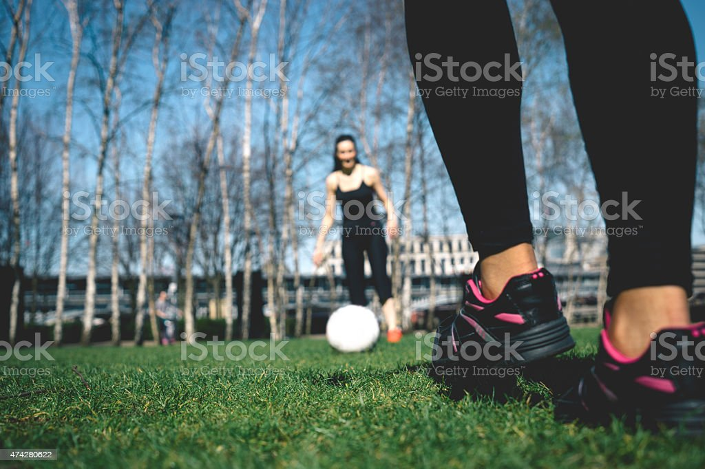Female Soccer, Close-up Of Foot Kicking Soccer Ball stock photo