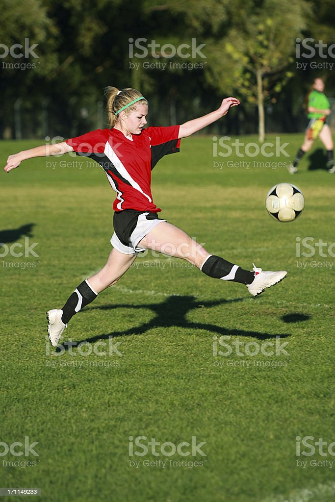 Female Soccer Flying Mid-air Touch on Ball stock photo