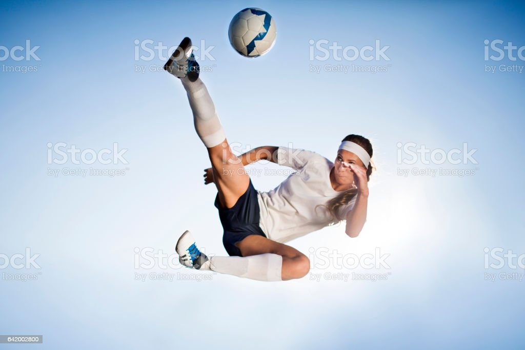 Female soccer player - bicycle kick stock photo