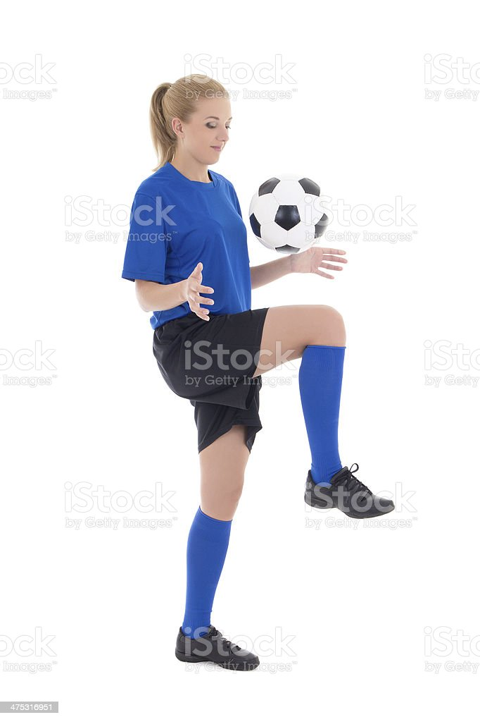 female soccer player in blue uniform playing with ball isolated stock photo