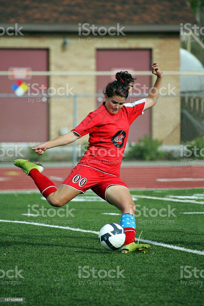 Female Soccer Player in Red Power Kicks Scoring Strike royalty-free stock photo