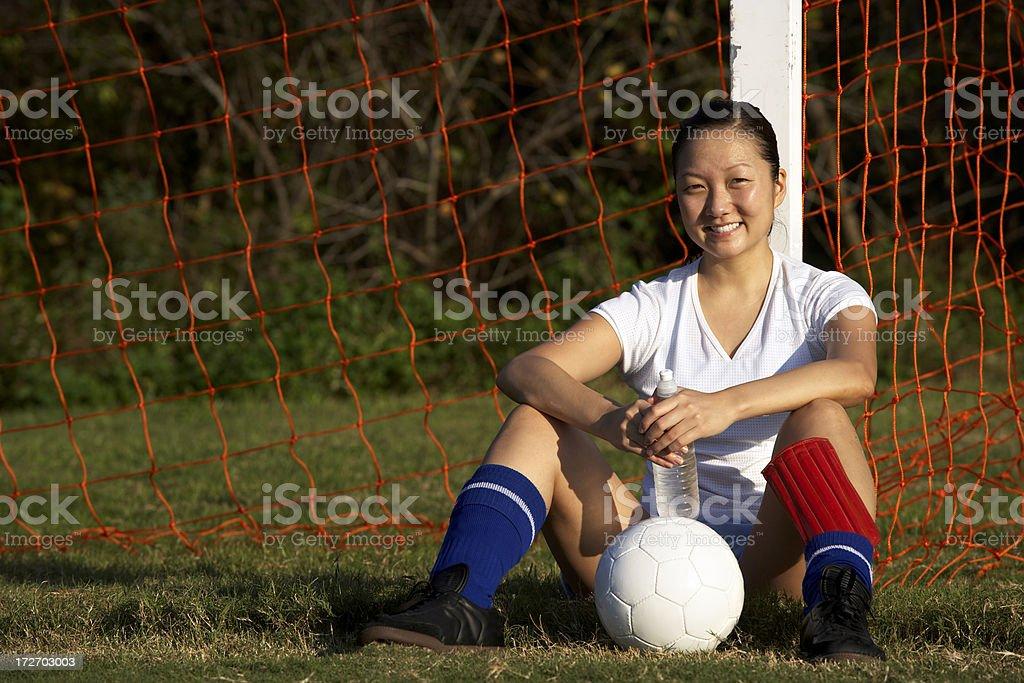 female soccer player  resting stock photo