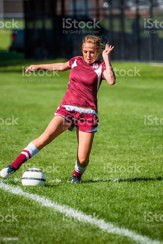 Female Soccer Player Stretches fo Line Save with Copy Space stock photo