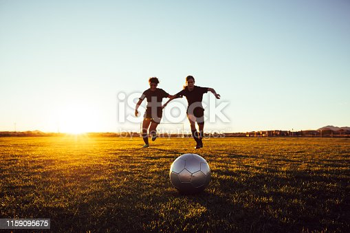 istock Female Soccer Players Battle for Ball 1159095675