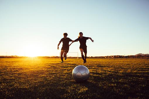 Female Soccer Players Battle for Ball