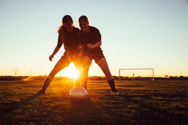Female Soccer Players Battle for Ball stock photo