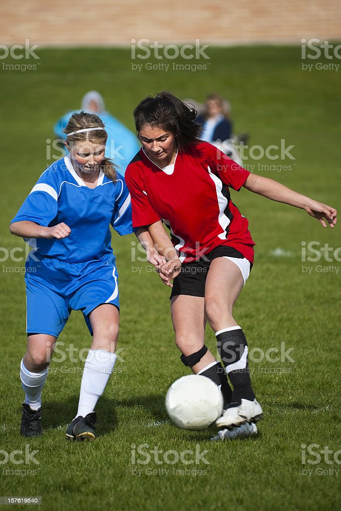 Female Soccer Players Challenge for Fifty-fifty Ball royalty-free stock photo