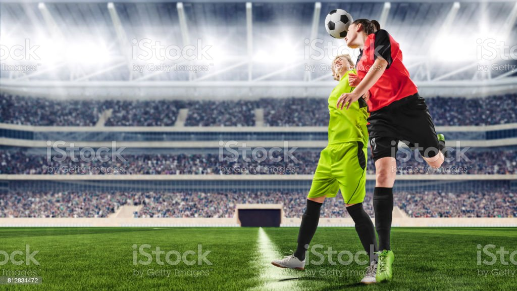 female soccer players having a scrimmage on a soccer match stock photo