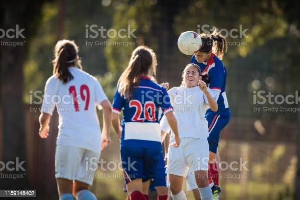 Female soccer players heading the ball on a match picture id1159148402?b=1&k=6&m=1159148402&s=612x612&h=yr5 cieorruhz1oyxro vx6dq7jzycric7vgb04654q=