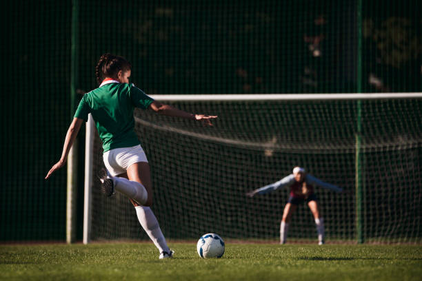 Female soccer players - penalty shot stock photo