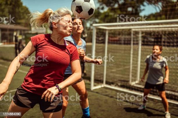 Female soccer striker heads ball into the goal picture id1224884090?b=1&k=6&m=1224884090&s=612x612&h=dvtmu nhfwe9msjjdqfgvz5yysfrp8b3vuq3jqabnn4=