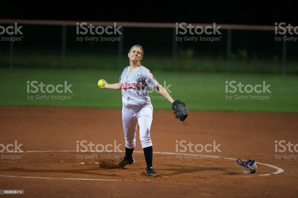Female Softball Player Throwing the Ball