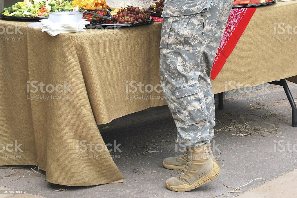 Female soldier eating. stock photo