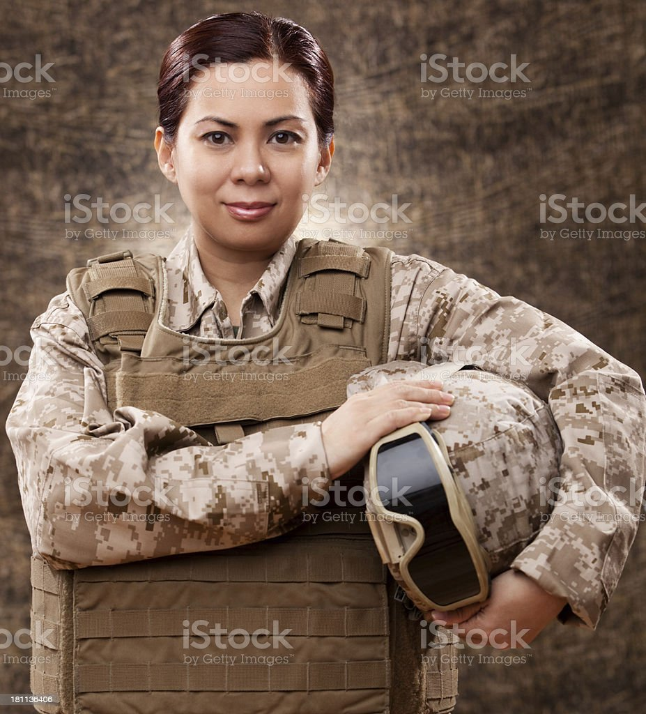 Female soldier in combat gear stock photo