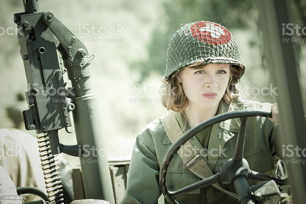 WWII Female soldier medic driving military vehicle stock photo
