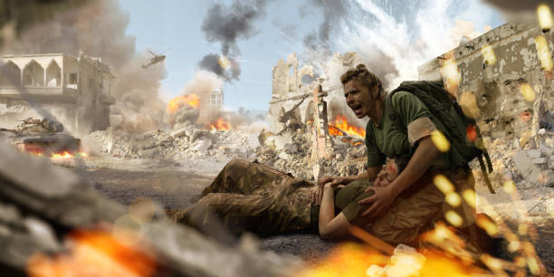 Female Soldier Medic Helping Injured Female Soldier In War Zone A female soldier medic wearing combat military uniform and backpack kneels on the ground and shouts for help whilst holding the head of an injured female colleague on her lap. The military personnel are both in a the middle of war zone amidst ruined buildings near explosions, smoke and fire. battlefield stock pictures, royalty-free photos & images