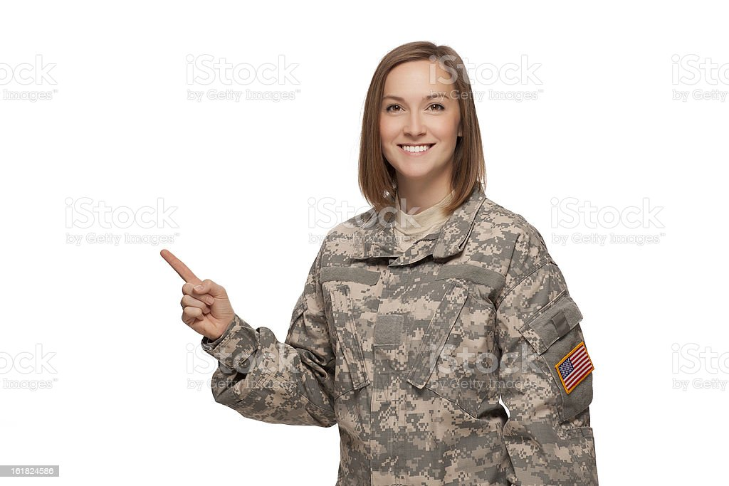 Female soldier pointing up royalty-free stock photo