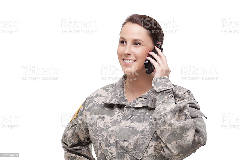 Female soldier using mobile phone royalty-free stock photo