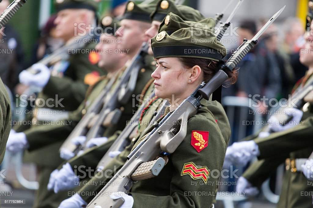 Female soldier with a rifle stock photo