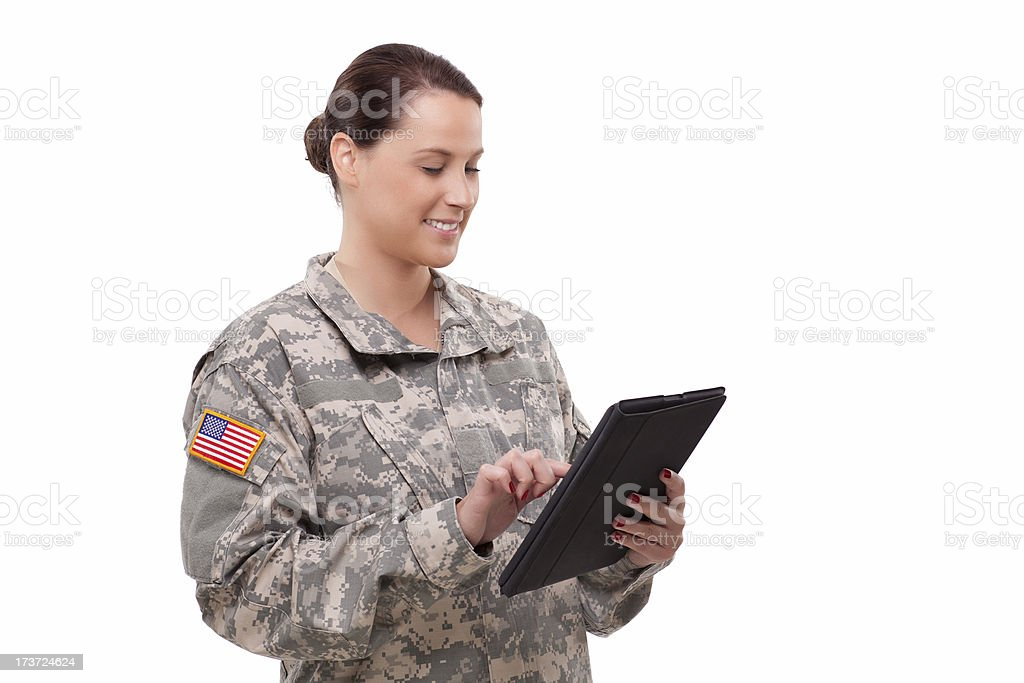 Female soldier with digital tablet stock photo