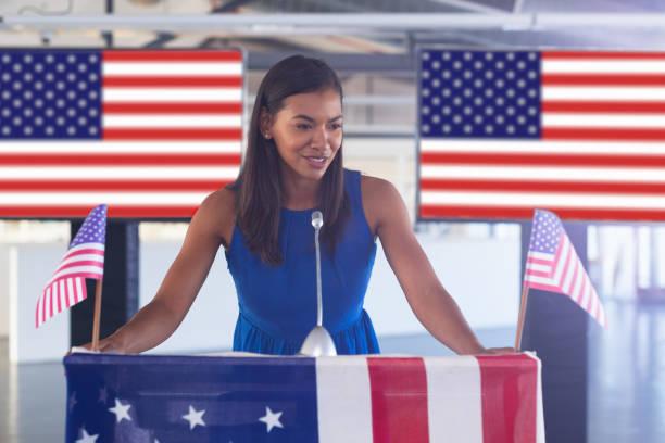 Female speaker speaks in a business seminar stock photo