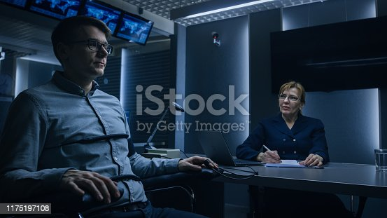 Female Special Agent Conducts Lie Detector / Polygraph Test on a Young Suspect. Expert Examiner Questions Accused in Interrogation Room. Computer Measures Physiological indices.