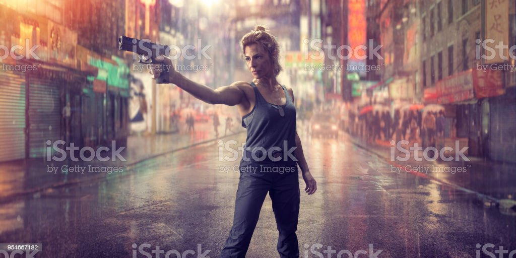 Female Special Forces Action Hero Soldier With Gun in Chinatown stock photo