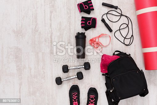 637596492istockphoto Female sport clothing and equipment top view 897936812