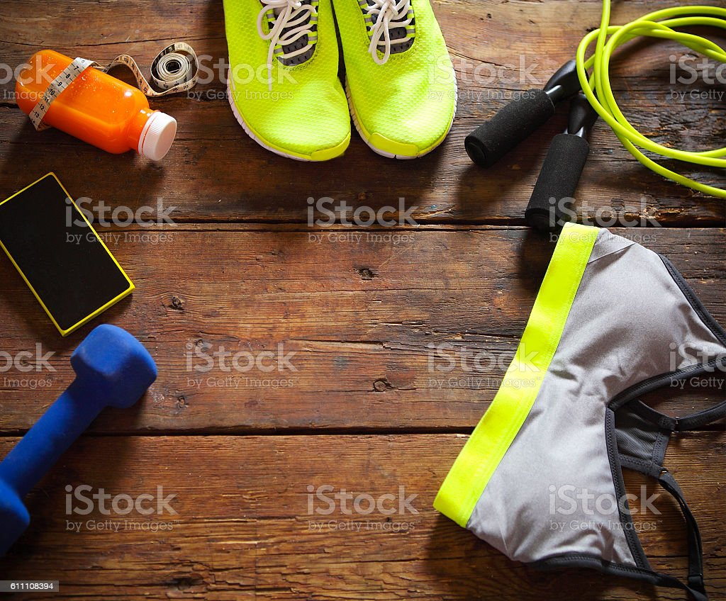Female sport equipment on a wooden background stock photo