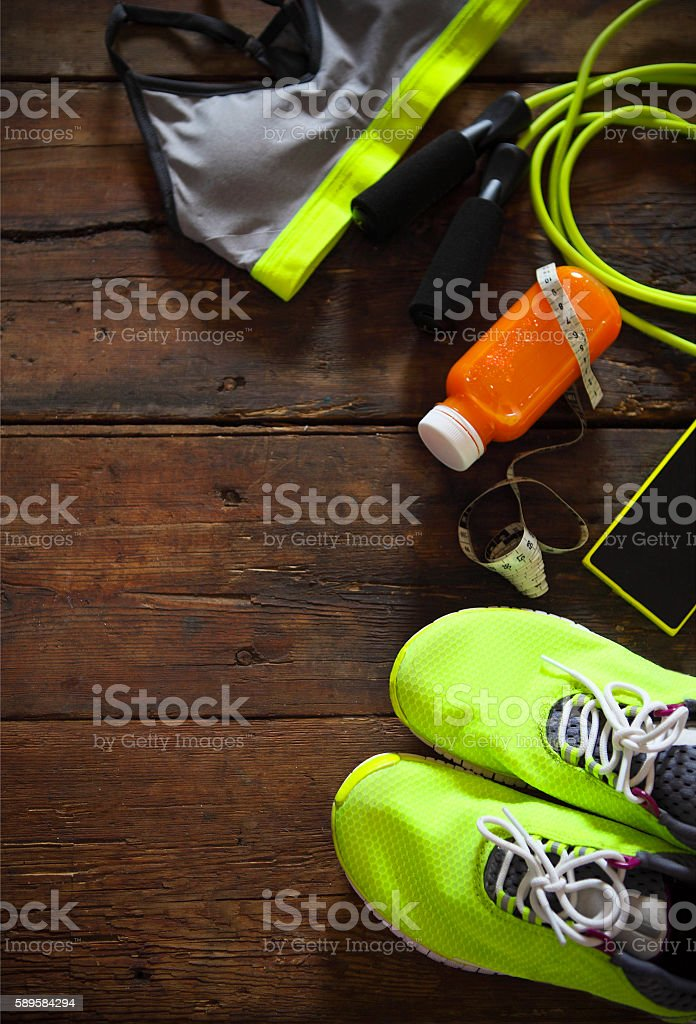 Female sport equipment on a wooden background. Sports items: sne stock photo