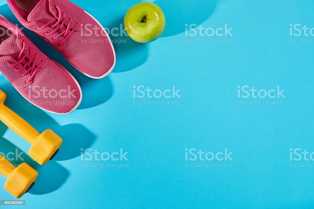 Female sport shoes and equipment top view, copy space. Active lifestyle, body care concept stock photo