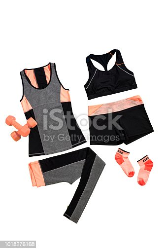 Female sports clothing with fitness equipments isolated on white background (with clipping path)