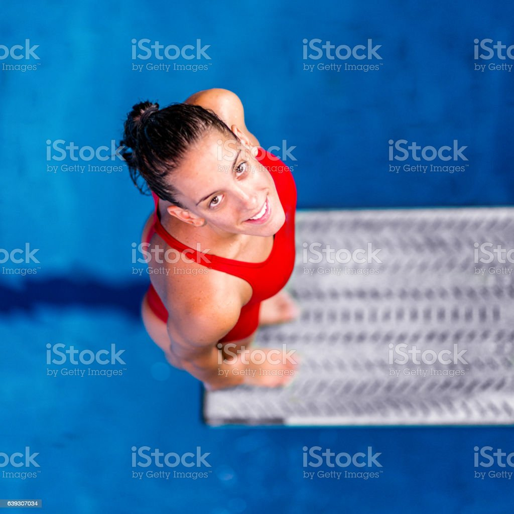 Female springboard diver, looking at the camera stock photo