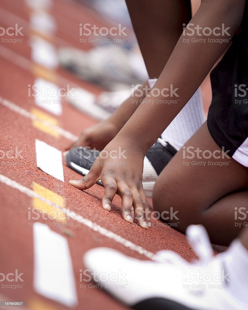 Female sprinter ready to race on track stock photo