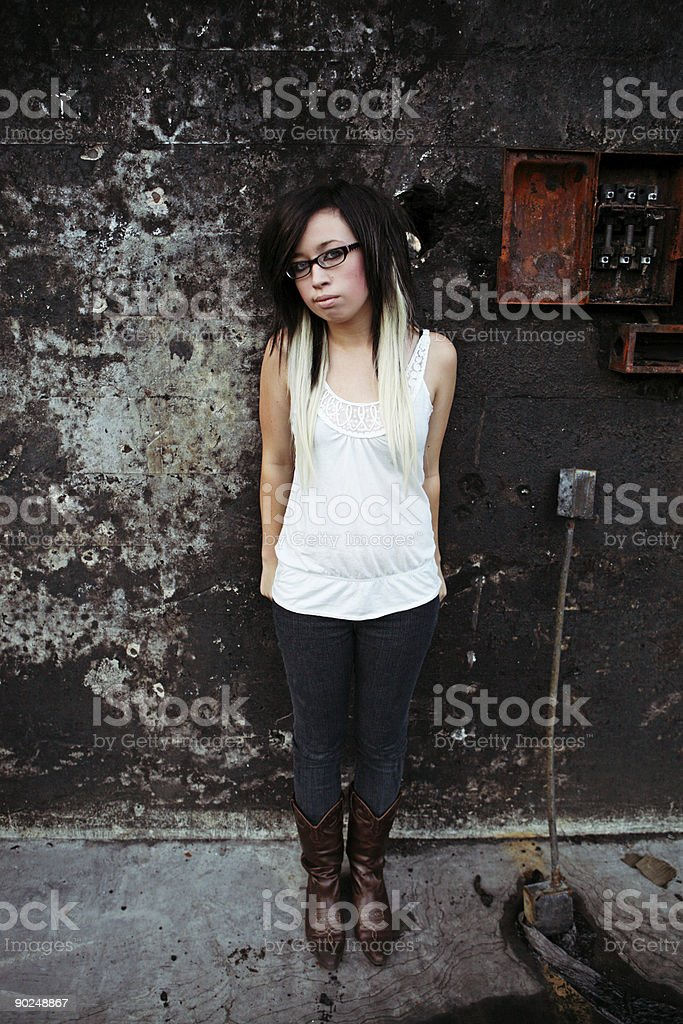 Female Standing Against Grunge Background royalty-free stock photo