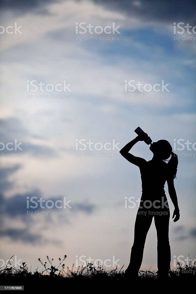 Female standing and refreshing royalty-free stock photo