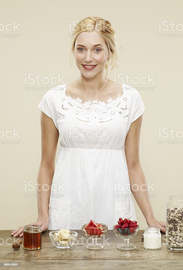 female standing in front of breakfast ingredients royalty-free stock photo