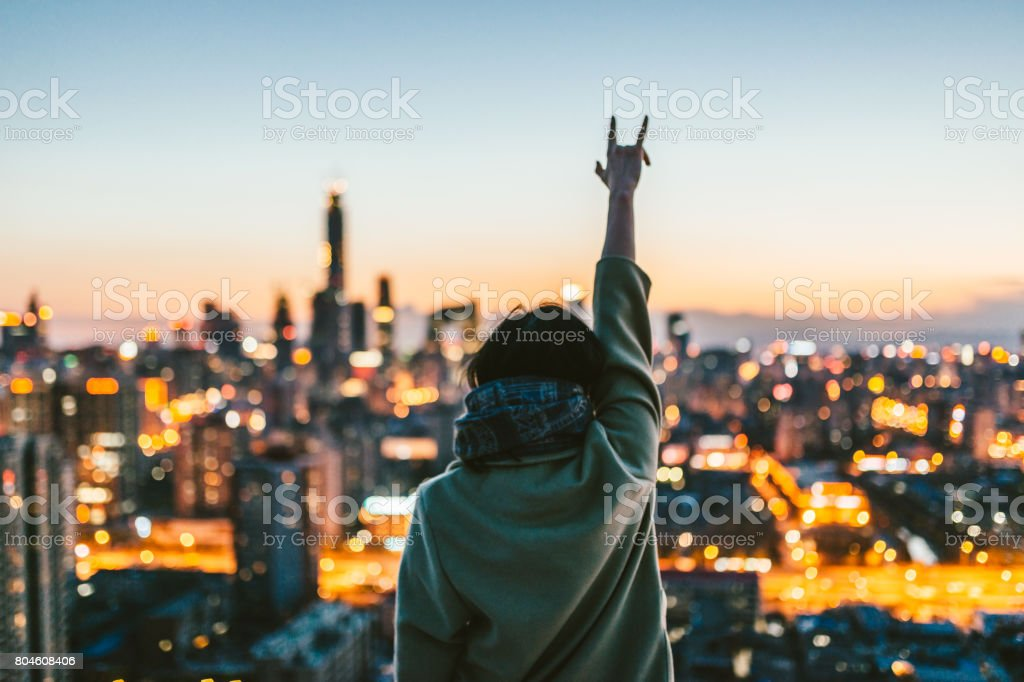 Female Standing in Front of Modern City stock photo