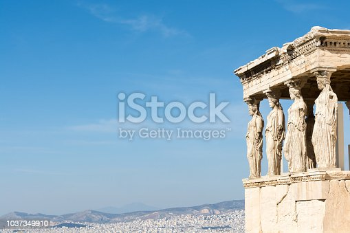 Female statues called caryatids in the Erechtheum at the sacred rock of the acropolis of Athens