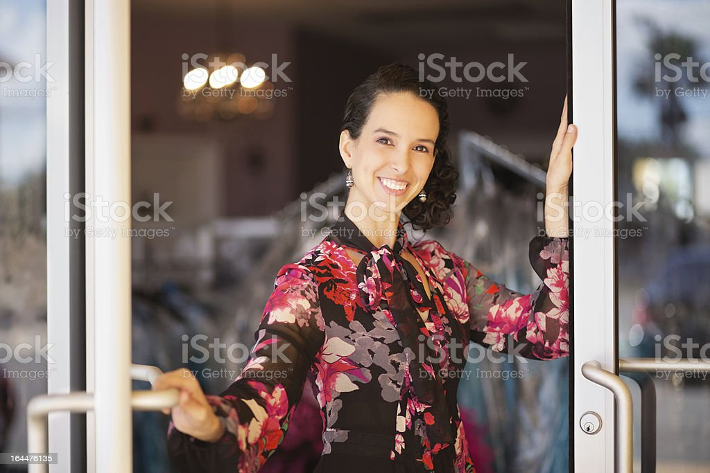 Female Store Owner Standing At Door royalty-free stock photo