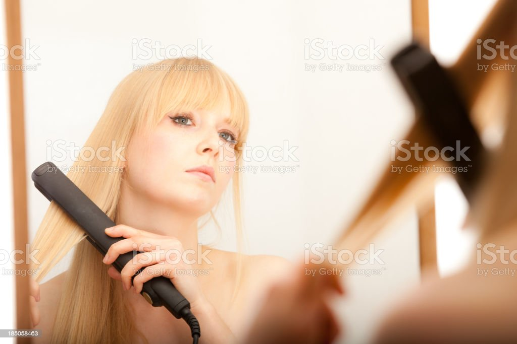 Female Straightening Hair royalty-free stock photo