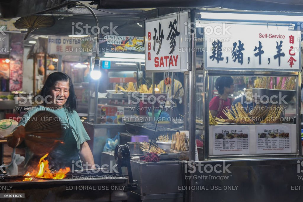 Female Street Food Vendor in Penang, Malaysia at night stock photo