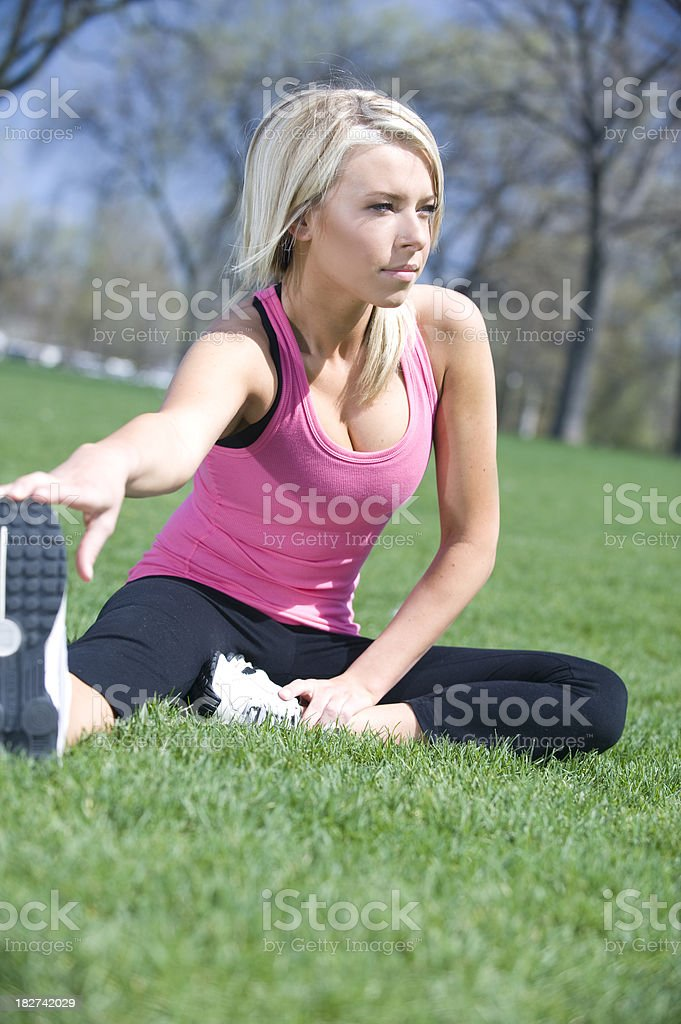 Female Stretches at Park royalty-free stock photo