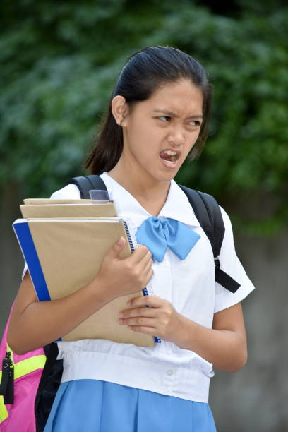 Female Student And Anger With School Books A person in an outdoor setting antagonize stock pictures, royalty-free photos & images