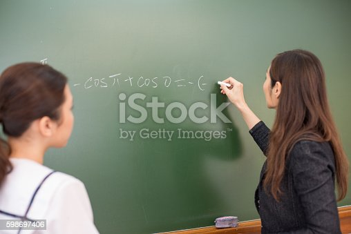 istock Female Student and Teacher Doing Math, Hong Kong School, China 598697406