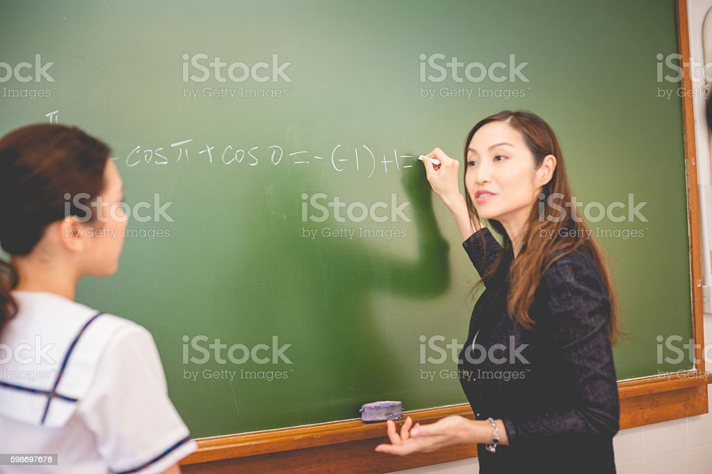 Female Student And Teacher Doing Math Hong Kong School China Stock ...