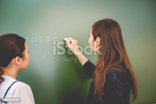 istock Female Student and Teacher Doing Math, Hong Kong School, China 636956066
