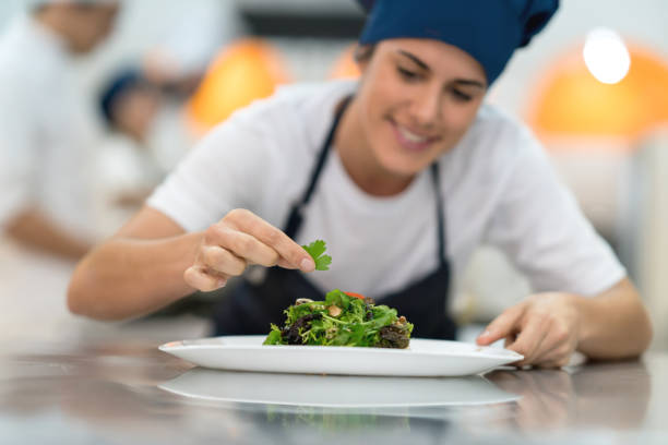 Female student at a gourmet institute finishing the details of a she picture id875991956?b=1&k=6&m=875991956&s=612x612&w=0&h=putcsdfreyqi1psercil3uae52trji3dqi3pces 3ds=