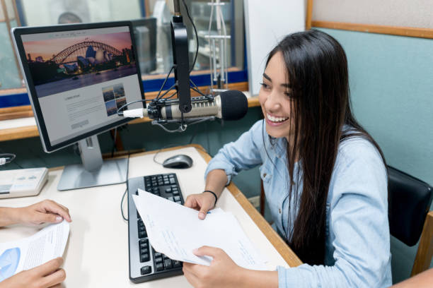 Female student broadcasting from the university's radio station stock photo
