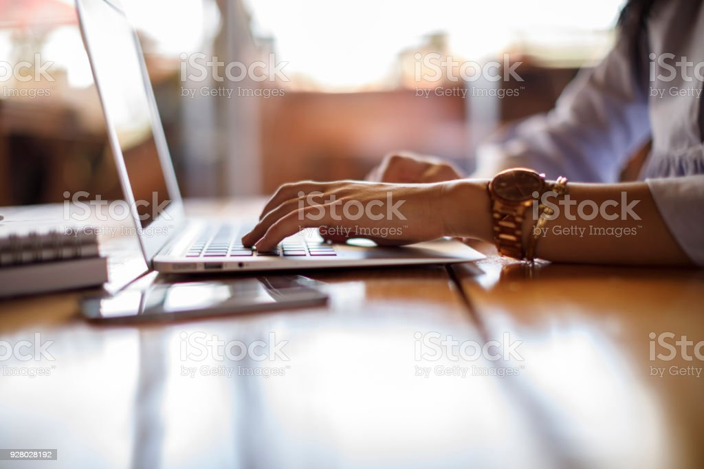 Female student checking her computer stock photo